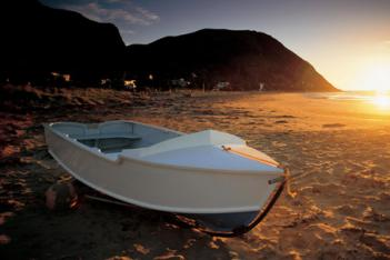 Empty boat on a beach