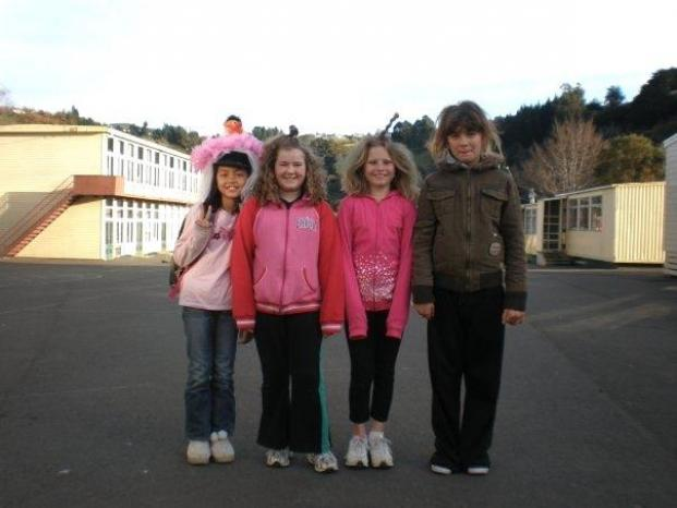 Arina as a child, posing with some primary school friends
