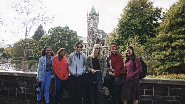 Arina and some university friends posing in front of the Otago University clock tower