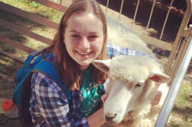 International student with Sheep