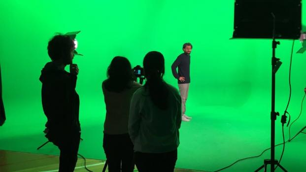 Indian internship students using the green screen