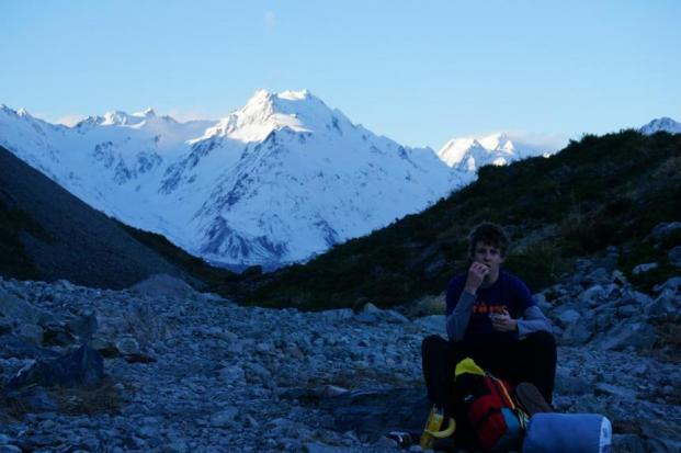 international student hiking in the mountains of the South Island, New Zealand