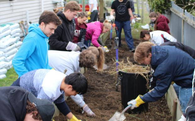 Students in the Rebuilding Christchurch 101 course build a garden at a community kindergarten.