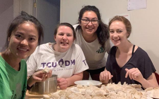 Maggie making dumplings with friends in her hall of residence