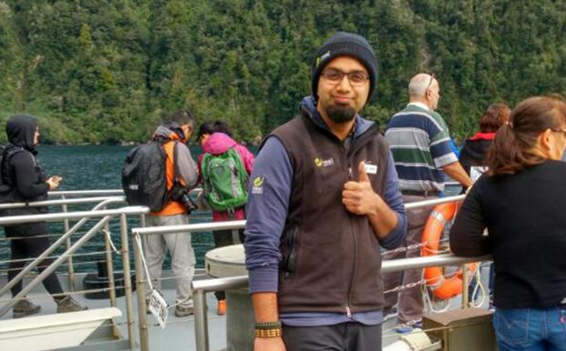 Indian international student Vedant Sharma on a boat in Fiordland