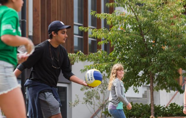 Students playing sport together