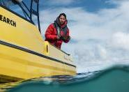 International student on boat carrying out research in New Zealand