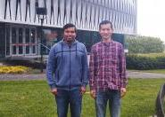 International students Alapan Roy and Jerry Geng outside their university in New Zealand