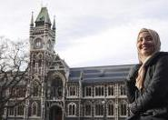 Arina stands in front of the iconic Otago University clock tower