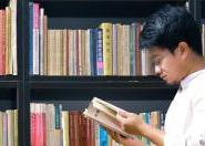International student reading in a university library