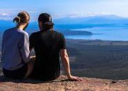 Ryan Hunt and his girlfriend on a mountain overlooking a lake